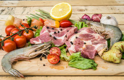 Fresh meat ,seafood  and vegetables on kitchen board. A set of seafood and vegetables Royalty Free Stock Images