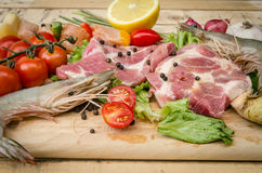 Fresh meat ,seafood  and vegetables on kitchen board. A set of seafood and vegetables Stock Photos