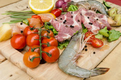 Fresh meat ,seafood  and vegetables on kitchen board. A set of seafood and vegetables Royalty Free Stock Photography
