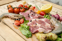 Fresh meat ,seafood  and vegetables on kitchen board. A set of seafood and vegetables Stock Image