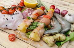 Fresh meat ,seafood  and vegetables on kitchen board. A set of seafood and vegetables Stock Images