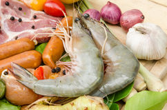 Fresh meat ,seafood  and vegetables on kitchen board. A set of seafood and vegetables Stock Photo