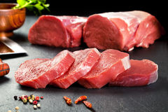 Fresh meat and sirloin steaks cruda.Medallones ready to cook. Stock Photo