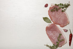 Fresh meat steaks on white wooden background.  Stock Images