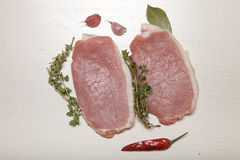 Fresh meat steaks on white wooden background.  Royalty Free Stock Photo
