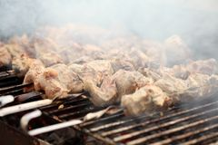 Fresh meat on a steel skewer in a brazier Royalty Free Stock Photo