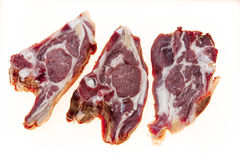 Fresh meat with streaks of fat. The raw lamb slices closeup. Australian lamb . Part of the carcass of a sheep saddle on the bone. Royalty Free Stock Image