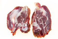 Fresh meat with streaks of fat. The raw lamb slices closeup. Australian lamb . Part of the carcass of a sheep saddle on the bone. Royalty Free Stock Images
