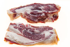 Fresh meat with streaks of fat. The raw lamb slices closeup. Australian lamb . Part of the carcass of a sheep saddle on the bone. Stock Images