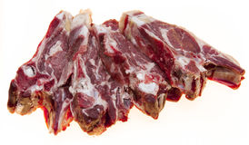 Fresh meat with streaks of fat. The raw lamb slices closeup. Australian lamb . Part of the carcass of a sheep saddle on the bone. Royalty Free Stock Photos