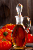 Fresh meat tomatoes and a carafe of olive oil Royalty Free Stock Images