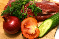 Fresh meat with vegetables. Red fresh meat with cutted vegetables Stock Photos