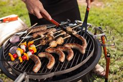 Fresh meat and vegetables on outdoor grill. Fresh meat and vegetables grilled at a summer weekend barbecue Stock Photos