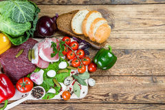 Fresh Meat, Vegetables and Spices. On board, food background Stock Images