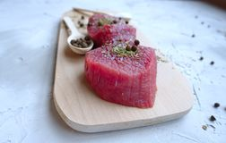 Fresh meat on a wooden board royalty free stock photography