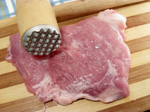 Fresh meat and wooden mallet Royalty Free Stock Image
