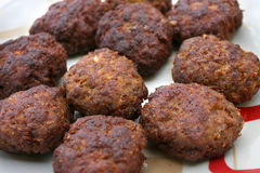 Fresh meatballs in a plate. Fresh many meatballs in a plate Royalty Free Stock Images
