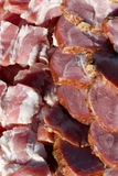 Fresh meats packed in rows Royalty Free Stock Photo