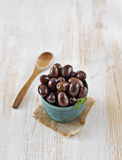 Fresh mediterranean olives in a rustic bowl. Typical spanish tapa. Stock Photography