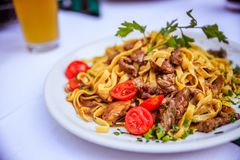 Fresh Mediterranean pasta with beef, Italy. Pasta italian dinner beef foodie fresh dente vegetables italy mediterranean herbage evening meal healthy tomatoes stock images