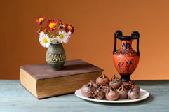 Fresh medlar on a plate and books Royalty Free Stock Image