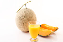 Fresh melon with a glass of juice. On the table Royalty Free Stock Images