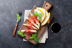 Fresh melon with prosciutto and basil Stock Image