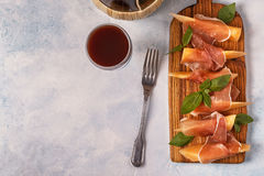 Fresh melon with prosciutto and basil. Stock Images