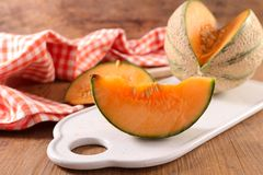 Fresh melon. On wood background Royalty Free Stock Images