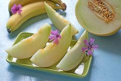 Fresh melons with bananas on blue background Royalty Free Stock Image
