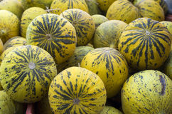 Fresh melons in open market. Under sunlight Royalty Free Stock Photos