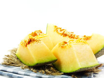 Fresh melons sliced on white background royalty free stock images
