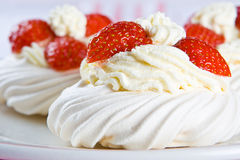 Fresh meringue with thick cream and stawberries Stock Photo