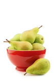 Fresh migo pears in a red ceramic bowl. On a white background Stock Images
