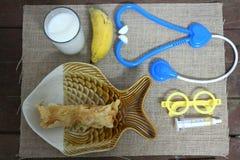 Fresh milk, banana flour, fried foods, health care And medical headphones.  royalty free stock photo