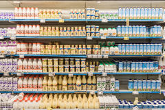 Fresh Milk Bottles On Supermarket Stand Royalty Free Stock Images