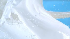Fresh Milk Bursting with Splash in the Air on Blue Background in Slow Motion at 1500 fps stock video footage