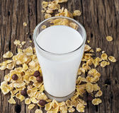 Fresh milk and cornflake on wooden table background Royalty Free Stock Photography
