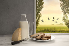 Fresh milk,cream bottle,bread,cheese in window to countryside Royalty Free Stock Image