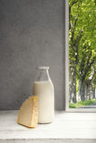 Fresh Milk,Cream bottle on window sill, trees Royalty Free Stock Photo