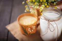 Fresh milk and curdled milk on the table. Stock Photo