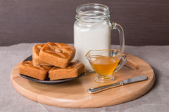 Fresh milk in glass and sweet cookies with honey Royalty Free Stock Images