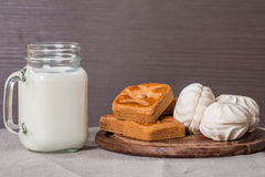 Fresh milk in glass and sweet cookies with zephyr Stock Photo