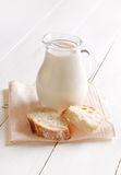 Fresh milk in jug and bread Stock Photos