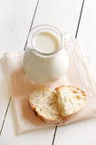 Fresh milk in jug and bread Stock Photography