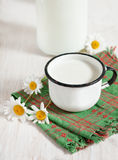 Fresh milk in metal mug Royalty Free Stock Photos
