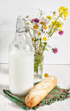 Fresh milk in old fashioned bottle with baguette Royalty Free Stock Photography