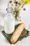 Fresh milk in old fashioned bottle with baguette Royalty Free Stock Photos
