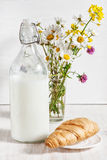 Fresh milk in old fashioned bottle with croissant Stock Images