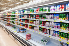 Fresh milk produces ready for sale in Auchan Samara Store Stock Photography